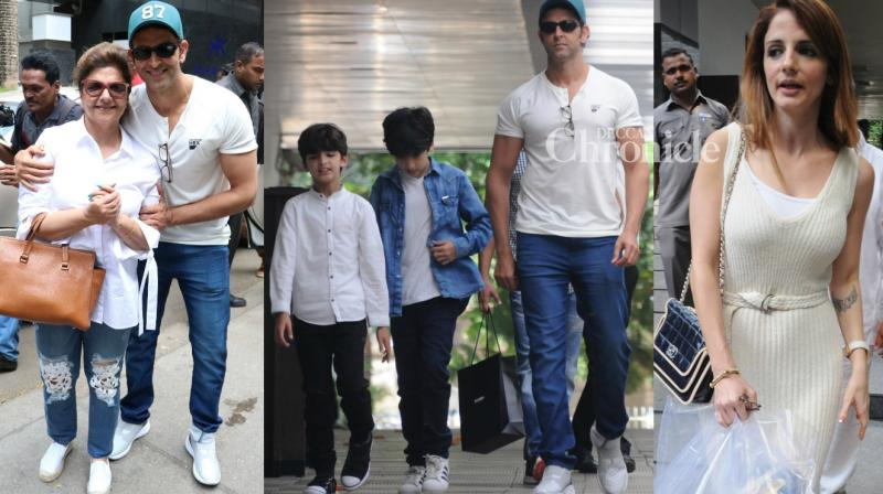 Estranged couple Hrithik Roshan and Sussanne Khan took their kids out for lunch on the occasion of Mother's Day in Mumbai on Sunday. Hrithik's parents Rakesh and Pinky Roshan were also spotted along with them. (Photo: Viral Bhayani)