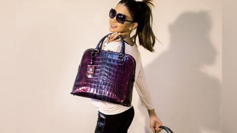 Recently, beauty mogul Kim Kardashian West bought Louis Vuitton Speedy Mini handbags for all the baby girls in the Kardashian-Jenner clan. (Photo: ANI)