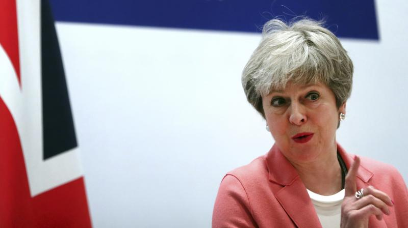 With May humiliated and weakened, ministers lined up to insist she was still in charge and to deny a reported plot to demand she name a date to leave office. (Photo:AP)