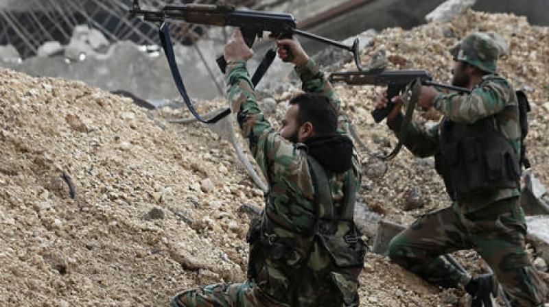 Syrian army soldiers fire their weapons during a battle with rebel fighters at the Ramouseh front line, east of Aleppo. (Photo: AP)