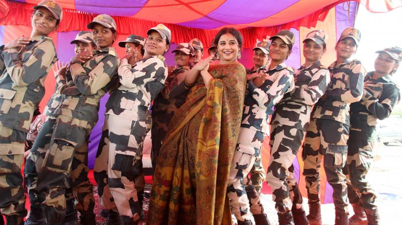 "The 'Tumhari Sulu' star lives up to the film's tag-line ""Main Kar Sakti Hai"" with women soldiers."