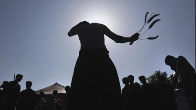 Shiite Muslims flagellates himself with knives on chains during a Muharram procession in Islamabad, Pakistan on Monday, September 9, 2019. Muharram, the first month of the Islamic calendar, is a month of mourning for Shiites in remembrance of the death of Hussein, the grandson of the Prophet Muhammad, at the Battle of Karbala in present-day Iraq in the 7th century. (Photo: AP)