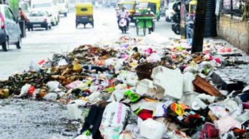 Due to irregular visits of tippers, residents says they were forced to dump garbage on the road side. (Representational image)