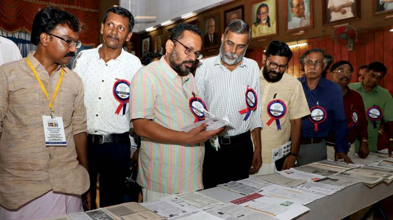 Sathar (extreme left) Chief Whip K. Rajan and writer  T.D. Ramakrishan at the show held in Kerala Sahithya Akademi Hall in view of  International Literacy Day.