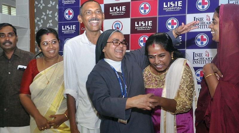 Sr. Alphonsa Koottala, transplant co-ordinator at Lisie Hospital shares a light moment with from (left) Bindukumar, wife Preeta, Muhammed Ashraf, Shijitha and Selina on the occasion of kidney donor-recipient get-together at the hospital in Kochi on Tuesday. — DC