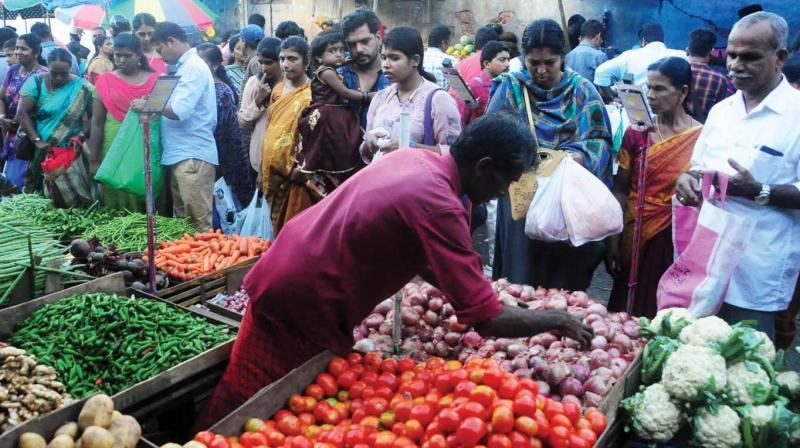 Busy buyers at the vegetable market at Palayam, Kozhikode on Tuesday.  (Photo:  Venugopal)