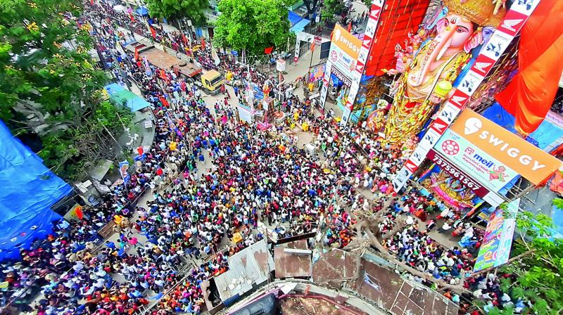 On Tuesday, devotees made their way to Khairtabad to visit the huge Ganesha. Even, Telangana state governor Tamilisai Soundararajan visited the pandal.(Photo: S. Surender Reddy)