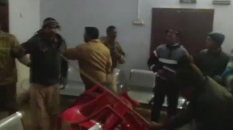 During the programme, supporters of both the leaders clashed over taking credit for the distribution, injuring some of them. (Photo: ANI/Twitter)