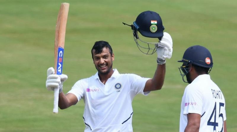 Mayank Agarwal completed his maiden Test hundred while Rohit Sharma made 176 on his opening debut as India headed towards a huge first innings total at lunch on day two of the series opener against South Africa here on Thursday. (Photo:AFP)