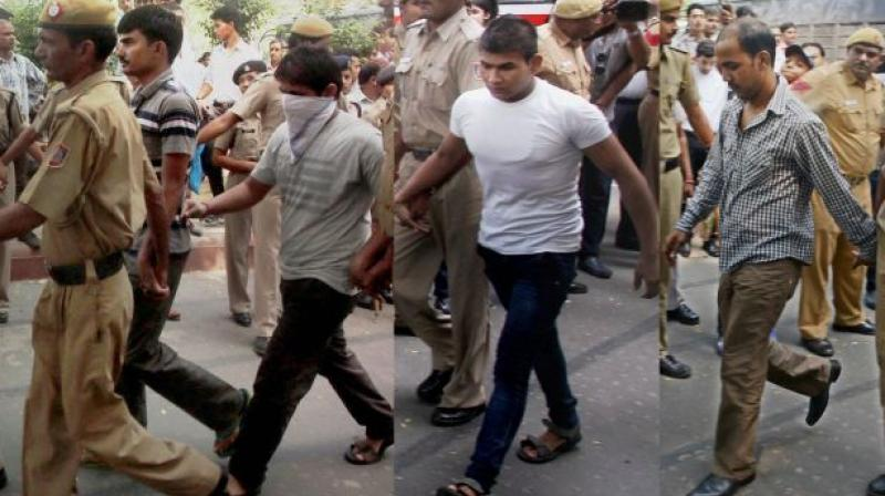 Delhi gangrape convicts Akshay Thakur, Pawan Gupta (face covered), Vinay and Mukesh Singh (R)