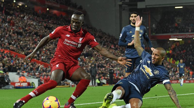 Senegal winger Mane put Liverpool ahead in the 24th minute when he broke away from Ashley Young to meet Fabinho's sublime pass with a nimble piece of chest control before shooting past David De Gea. (Photo: AFP)