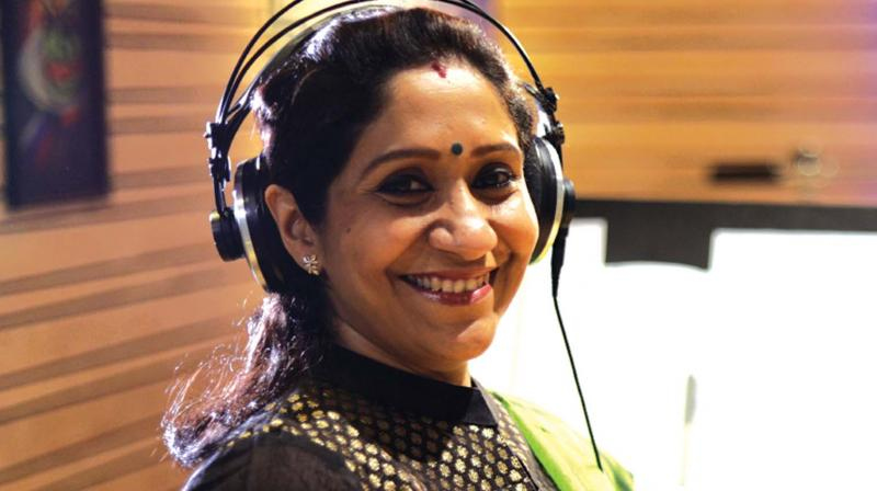 Singer Sujatha during a recording session