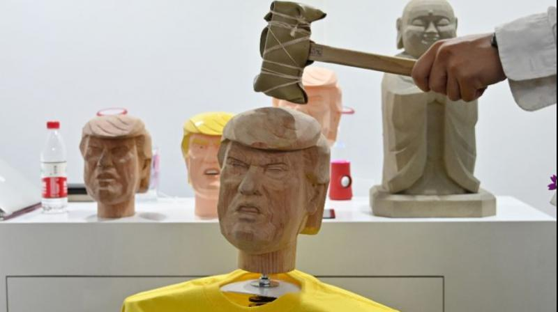 Visitors were given a hammer to smash a life-sized likeness of the US president, who has angered many Chinese by launching a tariff war with China. (Photo: AFP)