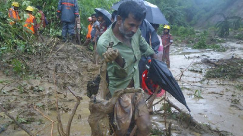 Local people said a landslide pushed 15 army men down to around 30 feet, killing four instantly while a military spokesman in Dhaka said an army major and a captain were among four of their dead personnel. (Photo: AP)