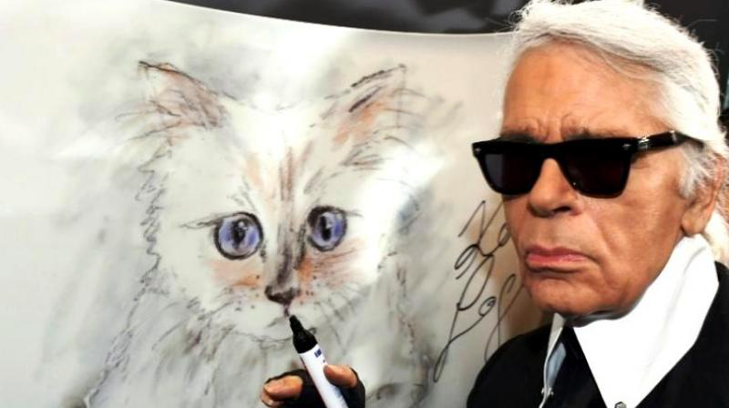 There is much speculation about whether his beloved fluffy white Birman cat, Choupette, will be present. (Photo: AFP)