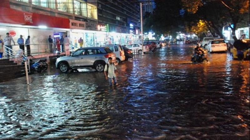 A four-month-old boy and his father were among three persons killed in rain-related incidents in the city lashed by heavy rain Monday evening. (Photo: Twitter)