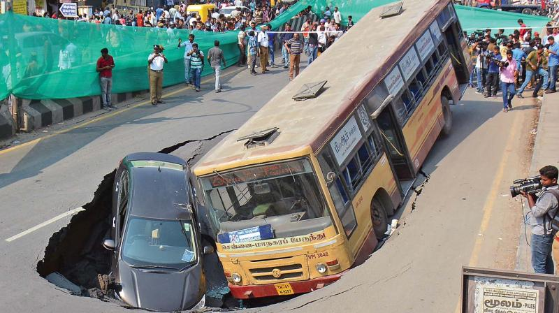 An MTC bus and a car were trapped in a crater which developed on Anna Salai on Sunday afternoon. (Photo: EK Sanjay)