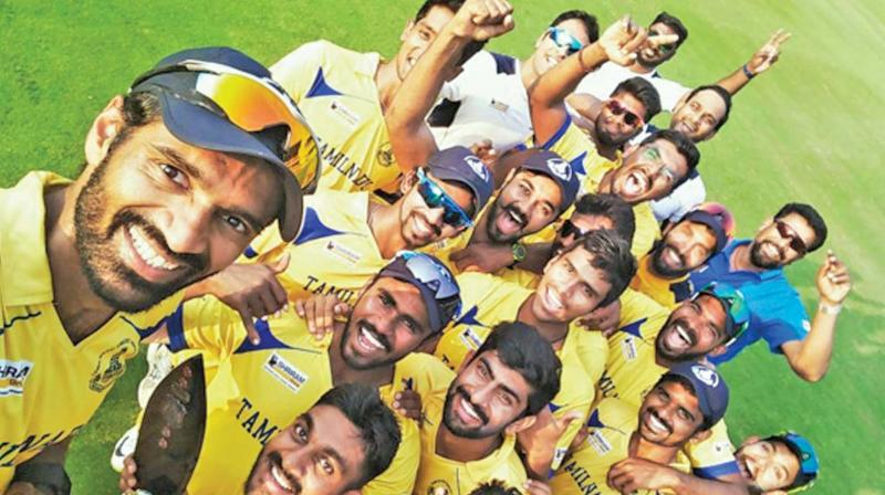 Members of Tamil Nadu cricket team celebrate after winning the Deodhar Trophy at Vizag on Wednesday. Tamil Nadu beat India 'B' by 42 runs to become the first state side to win the three-team one-day tournament. Wicket-keeper batsman Dinesh Karthik won the man of the match award for slamming a century in the final.