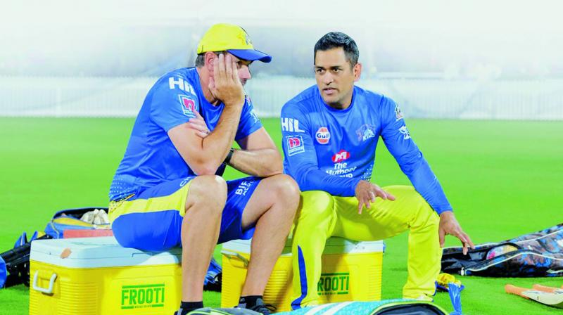 CSK captain M.S. Dhoni with coach Stephen Fleming during a training session at Chepauk. — Twitter