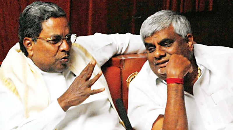 A file poto of Siddaramaiah with Revanna during a session