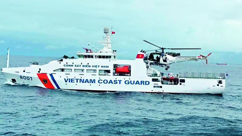 An Indian Coast Guard chopper lands on the Vietnamese Coast Guard ship as part of the first ever Indo-Vietnam Coast Guard Joint exercise conducted in the Bay of Bengal off Chennai on Thursday.