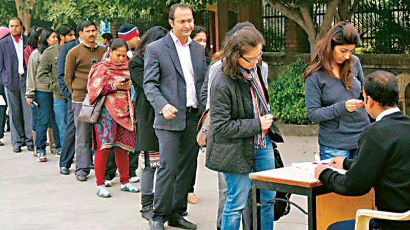 A file photo of parents waiting in a queue at a school for admission forms. (Photo: DC)