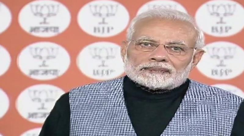 The prime minister was interacting with booth level workers of Vellore, Kanchipuram, Viluppuram and south Chennai districts of Tamil Nadu, and Puducherry, through video conferencing from New Delhi. (Photo: ANI | Twitter)