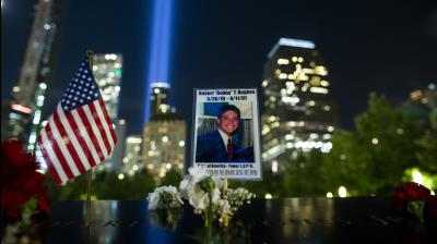 A picture of a man who lost his life in the attacks is seen at ground zero while the Tribute in Light rises in the background, in Lower Manhattan, Wednesday, September 11, 2019, in New York. Each year the city shines the powerful columns of light into the sky to represent the fallen twin towers of the World Trade Centre. (Photo: AP)