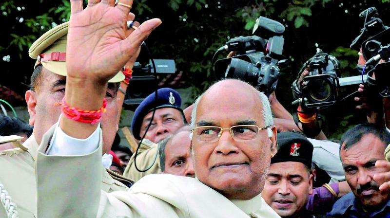 Bihar Governor Ram Nath Kovind waves as he leaves for Delhi, at Raj Bhavan in Patna on Monday. (Photo: PTI)