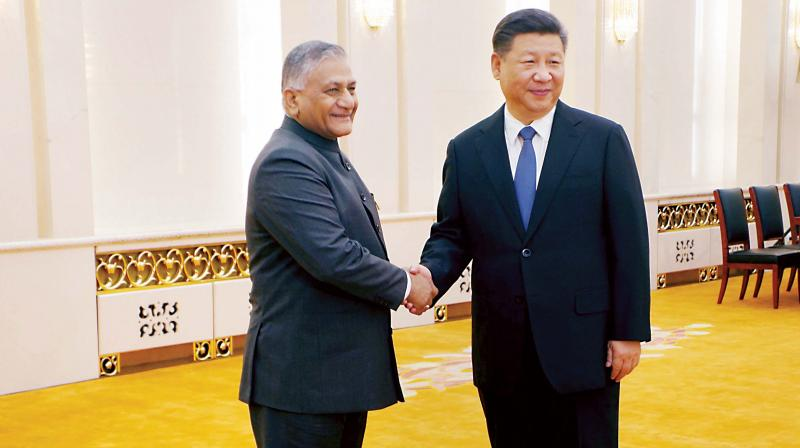 Minister of State for External Affairs General V K Singh shake hands with Chinese President Xi Jinping at Beijing on Monday. (Phtoo: PTI)