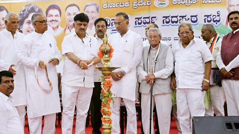 KPCC president Dinesh Gundurao and Water Resources Minister D.K. Shivakumar at a party meeting in Bengaluru on Wednesday