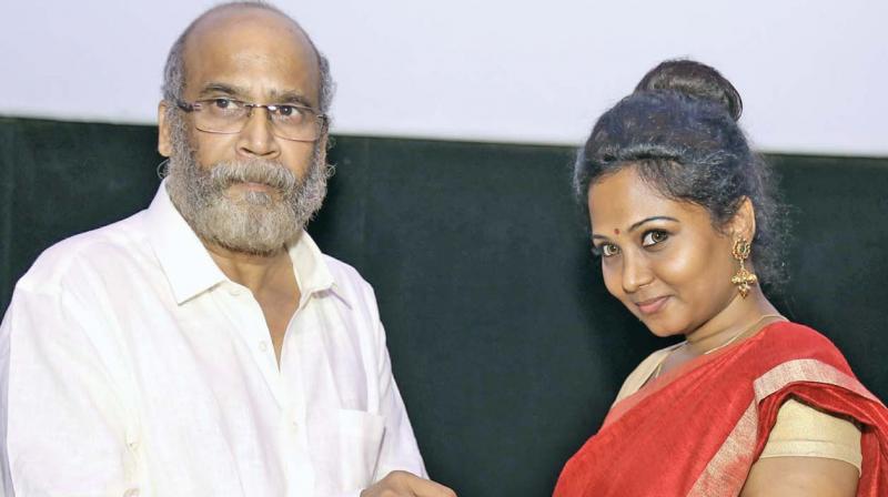 Velu Prabhakaran and Shirley exchanging rings