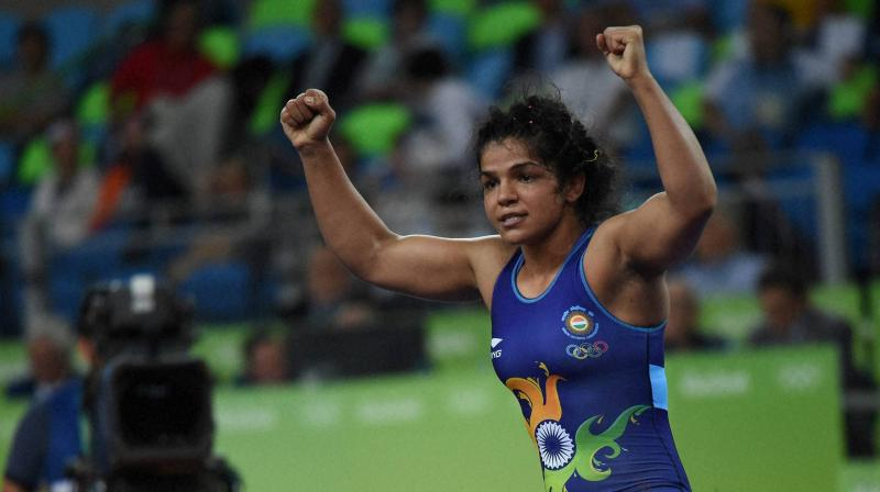 Sakshi lost a point for passivity but took the break with a 2-1 lead after a takedown move. (Photo: PTI)