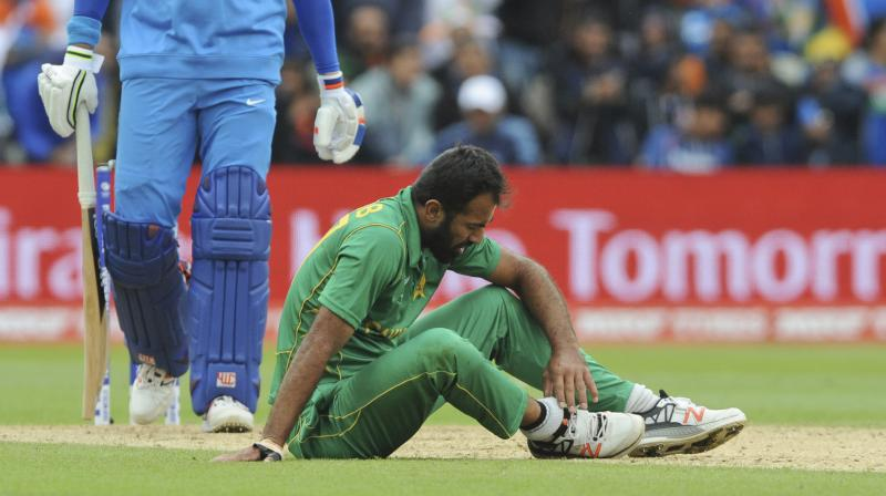 Pakistan's Wahab Riaz sits on the field holding his ankle after an injury during the ICC Champions Trophy match between India and Pakistan at Edgbaston in Birmingham. (Photo: AP)