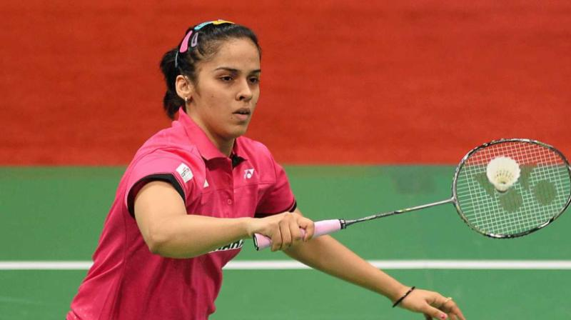 Saina Nehwal defeated PV Sindhu 21-13, 21-19 to enter the semi-final of the Indonesian Badminton Championships in Jakarta here on Friday. The experienced Saina who pocketed the first game with ease, rallied back in the second game to win the set and match .(Photo: AFP)