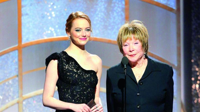 Emma had emerald green and white on her eyelids and violet on her lips. (Photo: DC)