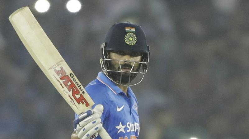 Virat Kohli is set to captain India for the first time in a major ICC event, and is fortunate to MS Dhoni have beside him, the calm and calculated wicketkeeper-batstman, who can seemingly win any game on his own and from any tough situation.(Photo: AFP)