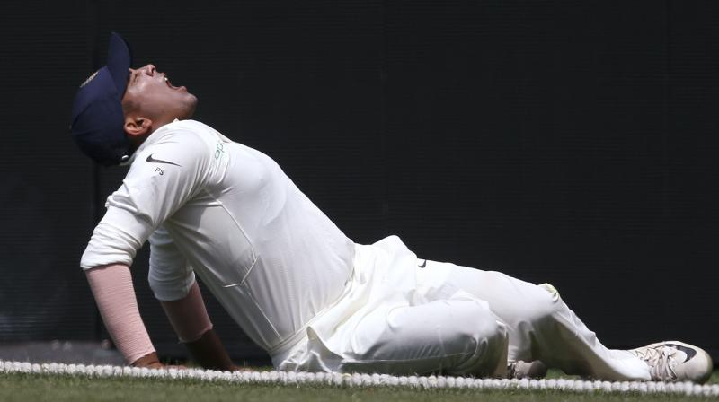 """""""Opening batsman Prithvi Shaw suffered a left ankle injury while attempting a catch at the boundary ropes in the tour game against CA XI at The Sydney Cricket Ground,"""" said the BCCI in a statement. (Photo: AP)"""
