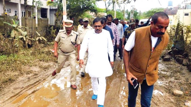 Deputy Chief Minister Dr G. Parameshwar visits a relief centre and rain affected parts of Kodagu district on Monday (Photo: KPN)