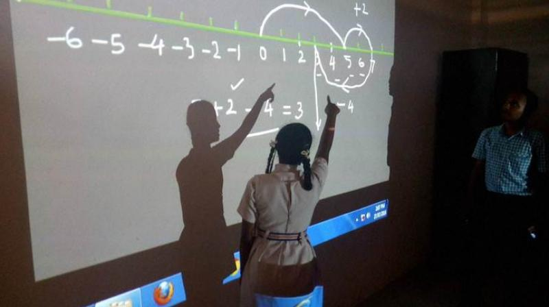 In Chhattisgarh's insurgency-hit Kanker district, children in over 100 government schools are learning basic maths through video lectures in Hindi. (Photo: PTI)