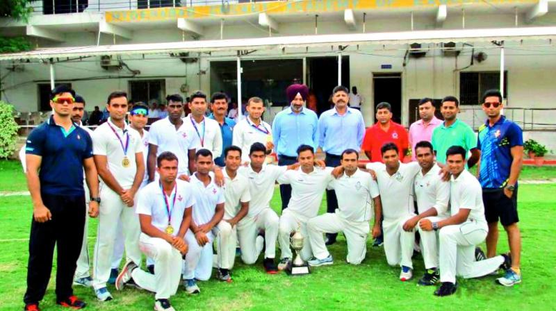 Members of the Air Force team pose after winning the 68th Inter Services Cricket Championship at the Gymkhana ground in Secunderabad on Monday.