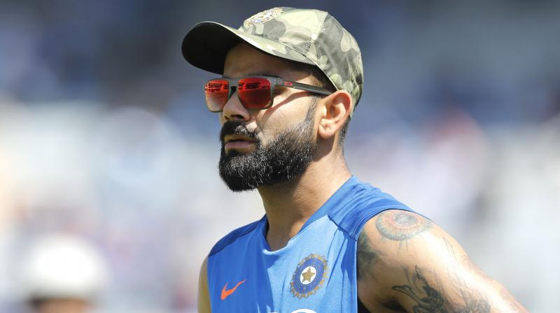 Kohli, who scored only 134 runs during India's previous tour of England in 2014, amassed 593 runs in his side's five-test series last year at an average of over 59 to book his place on the list. (Photo: AP)