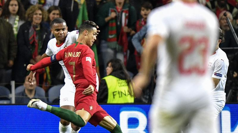 Ronaldo blasted Portugal ahead from a free kick in the 25th minute, his first goal for his country for nearly a year, but the Swiss equalised with a penalty after halftime which will raise more questions over the use of the VAR system. (Photo:AP)