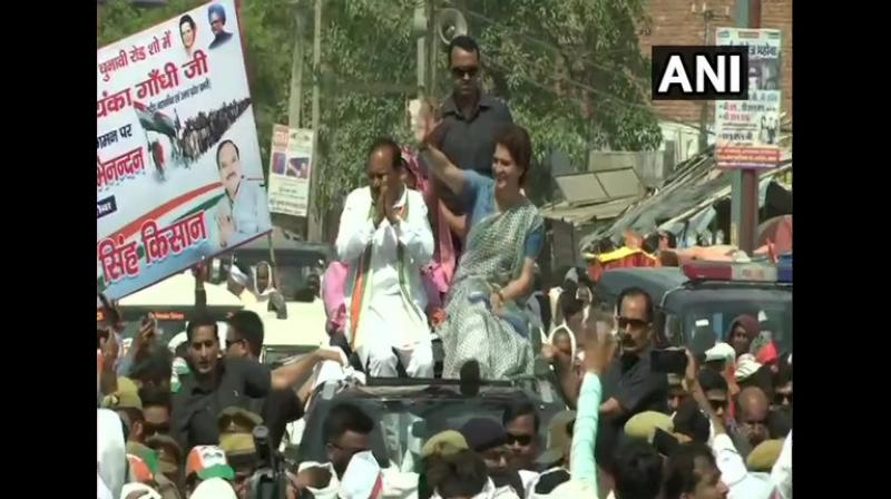 Pritam Singh joined Priyanka in the roadshow in which she waived to the party supporters. (Photo: ANI)