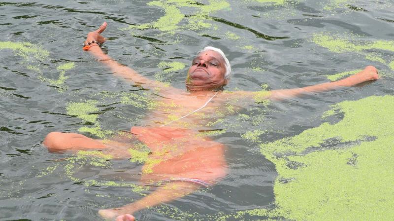 Yogacharya P.S Ananthanarayanan performs 'water yoga' in Vadakkechira in Thrissur on Friday.