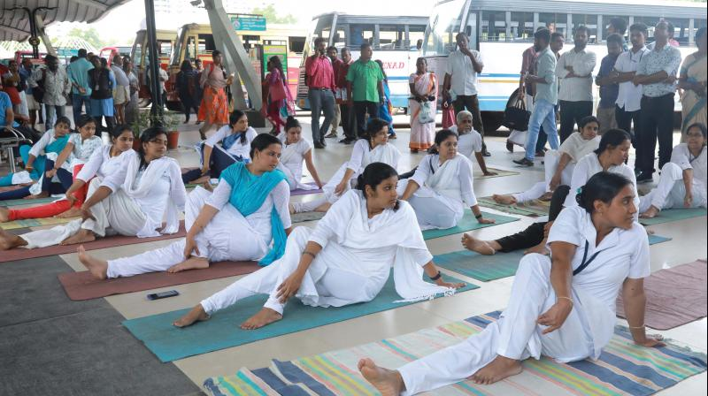 Participants take part in the yoga demonstration during the  International Day of Yoga held at Vytila mobility hub in Kochi on Friday. (Photo: ARUN CHADRABOSE)