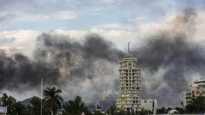 "Smoke from burning cars rises due in Culiacan, Mexico, Thursday, Oct. 17, 2019. An intense gunfight with heavy weapons and burning vehicles blocking roads raged in the capital of Mexico's Sinaloa state Thursday after security forces located one of Joaquín ""El Chapo"" Guzmán's sons who is wanted in the US on drug trafficking charges. (Photo: AP)"