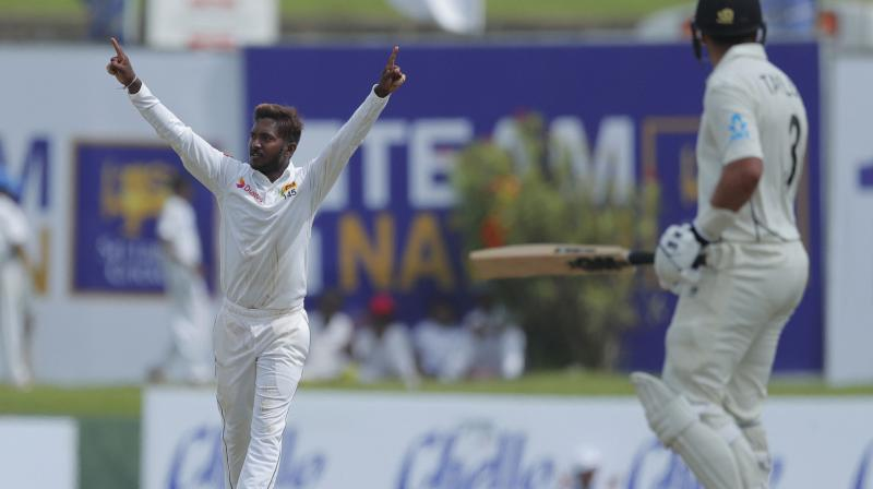Akila Dananjaya, bowling with a remodelled action after being reported for a suspect action last year, trapped BJ Watling for one at the stroke of tea to register his fourth five-wicket haul in six matches. (Photo:AP/PTI)