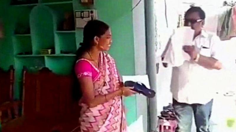Akula Hanumanth carried out a door-to-door campaign where he has been distributing slippers and a signed slip to citizens, asking them to hit him with the same if he doesn't fulfill their expectations after winning. (Photo: ANI)