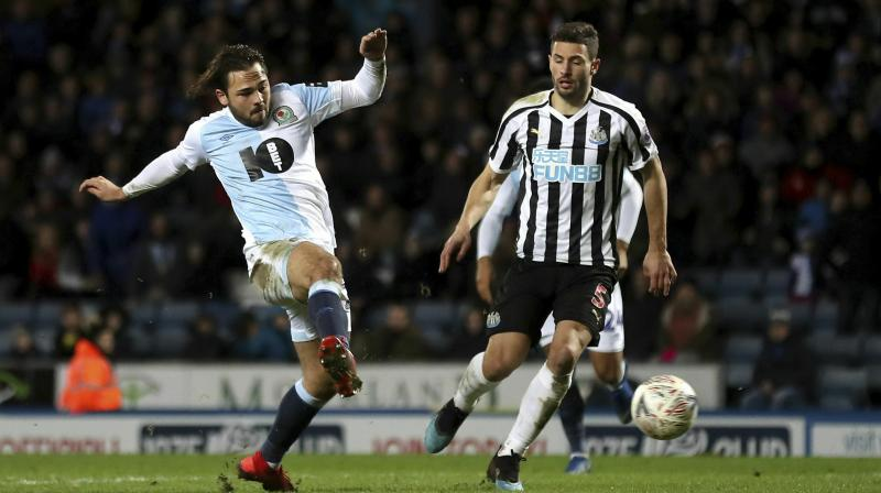Newcastle fans, who had seen their side narrowly escape defeat in the home match with Championship Blackburn, were given some respite from their top-flight struggles with a replay win against their fellow six-time FA Cup winners at Ewood Park. (Photo: AP)